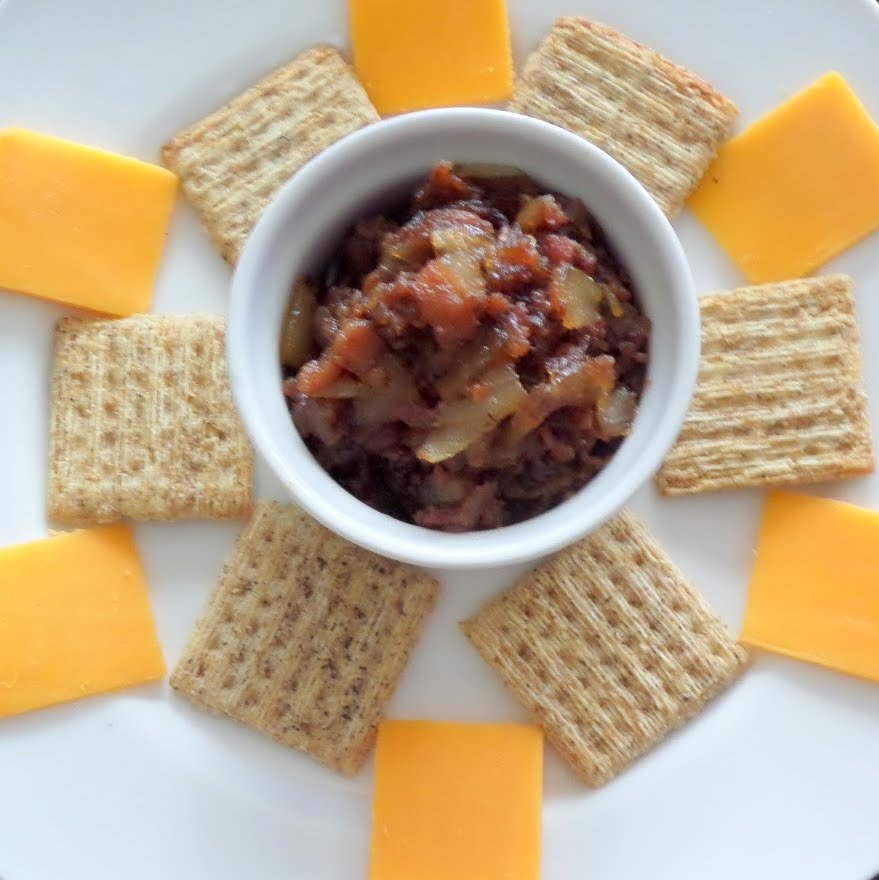 Bacon Jam:  Bacon, onions, and maple syrup cooked into a jam.  A great football snack, party snack, or just a snack on your own.