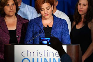 New York Democratic mayoral candidate Christine Quinn, with wife Kim Catullo, left, delivers her concession speech Tuesday night.
