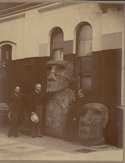 George Brown Goode, Samuel D. Langley, and Otis T. Mason with Two Moai (Lava Stone Effigy Figures) Inside Museum Building n.d., NAA 04960200
