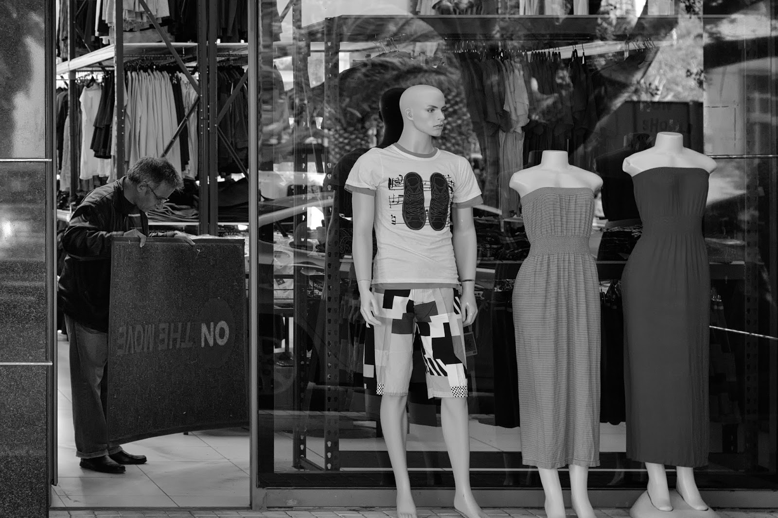 A shopkeeper and his mannequins