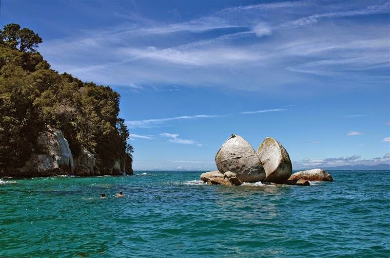 Split Apple Rock is a geological rock formation, Located in the turquoise hues of the Tasman Sea in Abel Tasman National Park on the South Island of New Zealand, sits the unique rock formation known as Split Apple Rock.