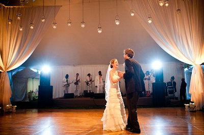 A line of hanging lanterns really makes a statement at this wedding reception.