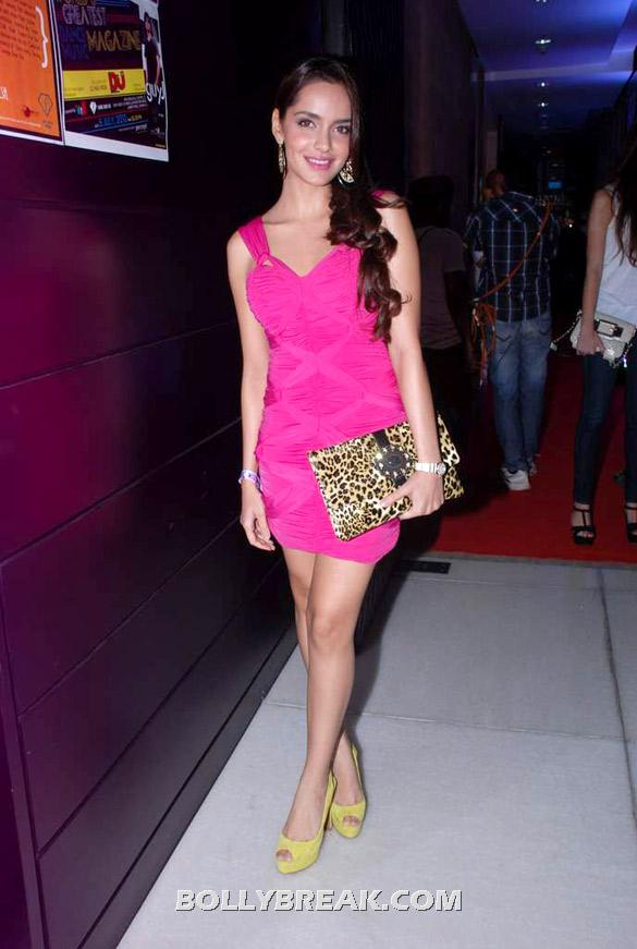 Shazahn Padamsee posing with a leopard print clutch and mustard yellow shoes - Shazahn Padamsee pink dress photos