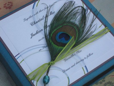 Tuck a peacock feather in your invites to add rich color