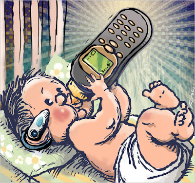 small baby holding a cell phone bottle