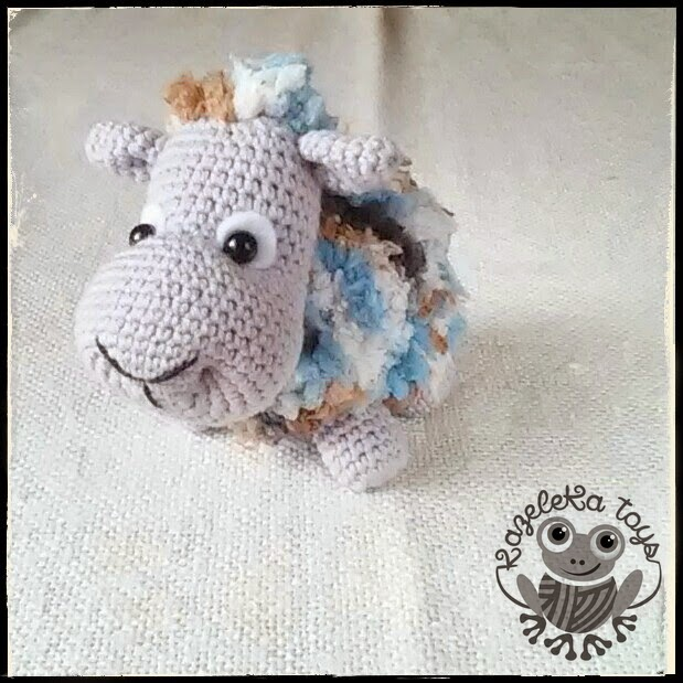 детская игрушка овечка