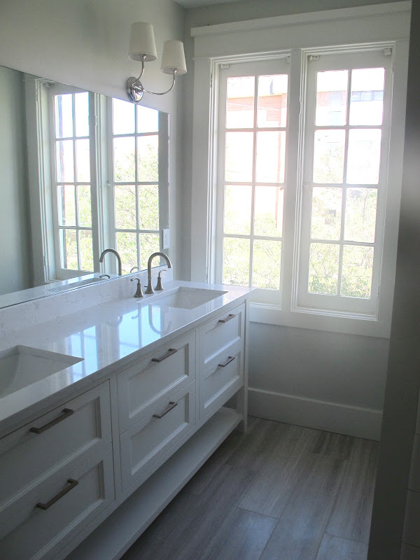 so we divided it up and made one half of the room the master bath title=