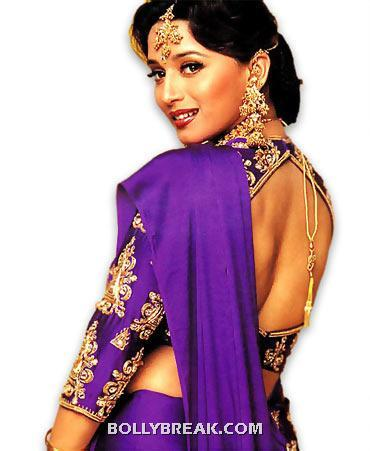 Madhuri pulled this purple traditional dress so effortlessly. This color and this dress became very popular upon the release of hum apke hain kaun - (8) - Memorable bollywood outfits over the years- hot!!
