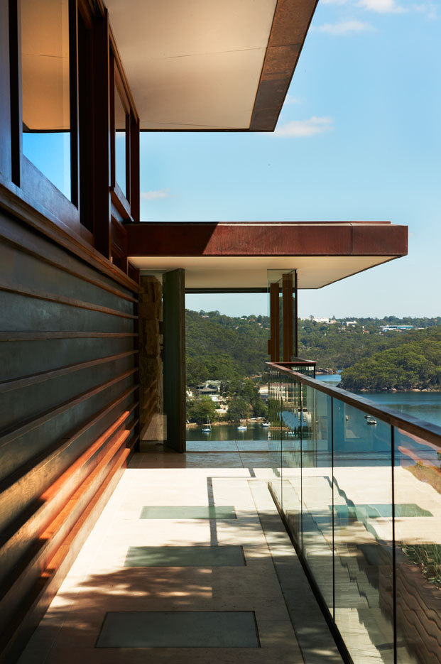 Balcony with glass railing looking on the bay