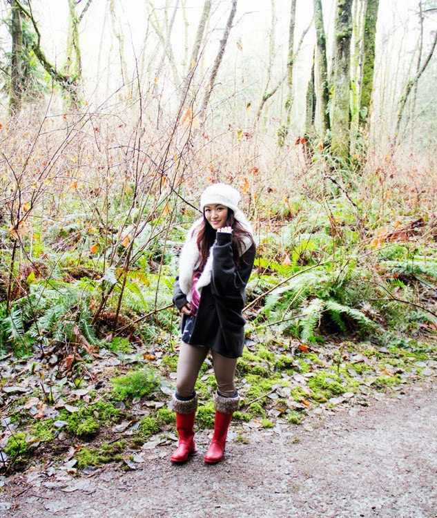 Jasmine Zhu vancouver fashion blogger wearing red hunter boots and obakki jacket in the forrest