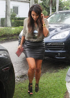 Kim Kardashian leegy in leather skirt