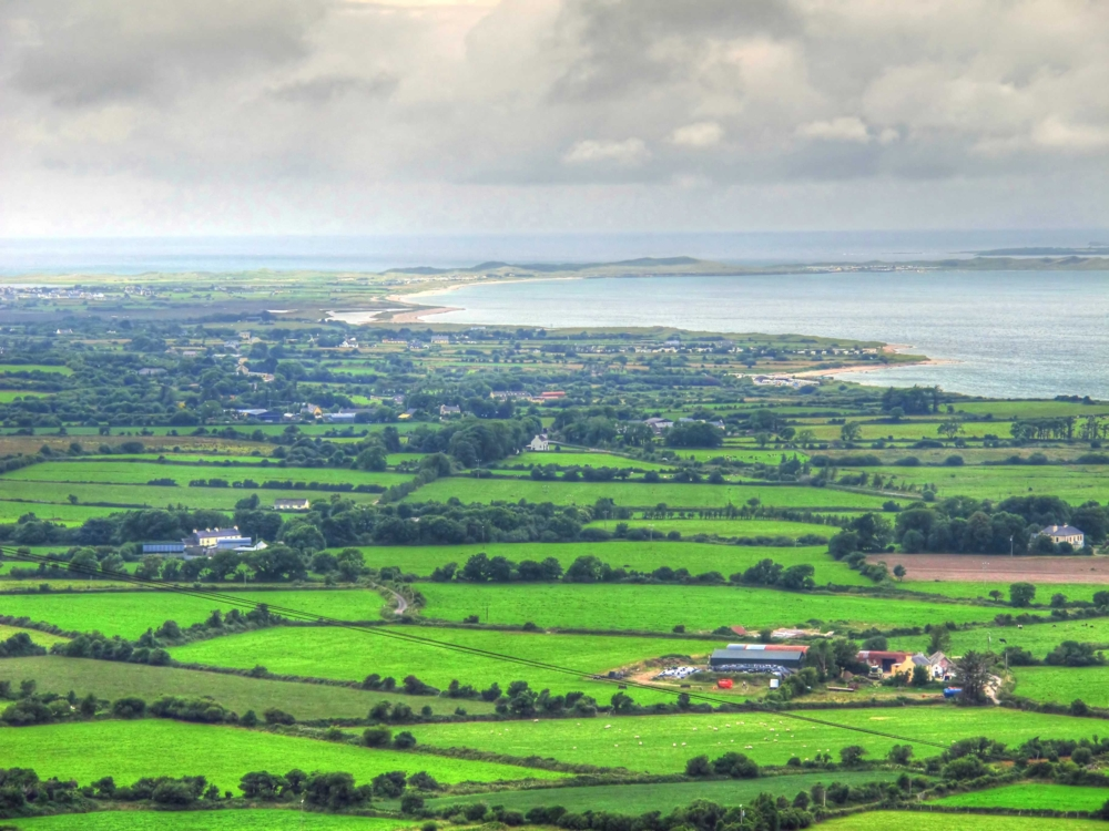 view of the green fields of dingle peninsula ireland photo by susan wellington
