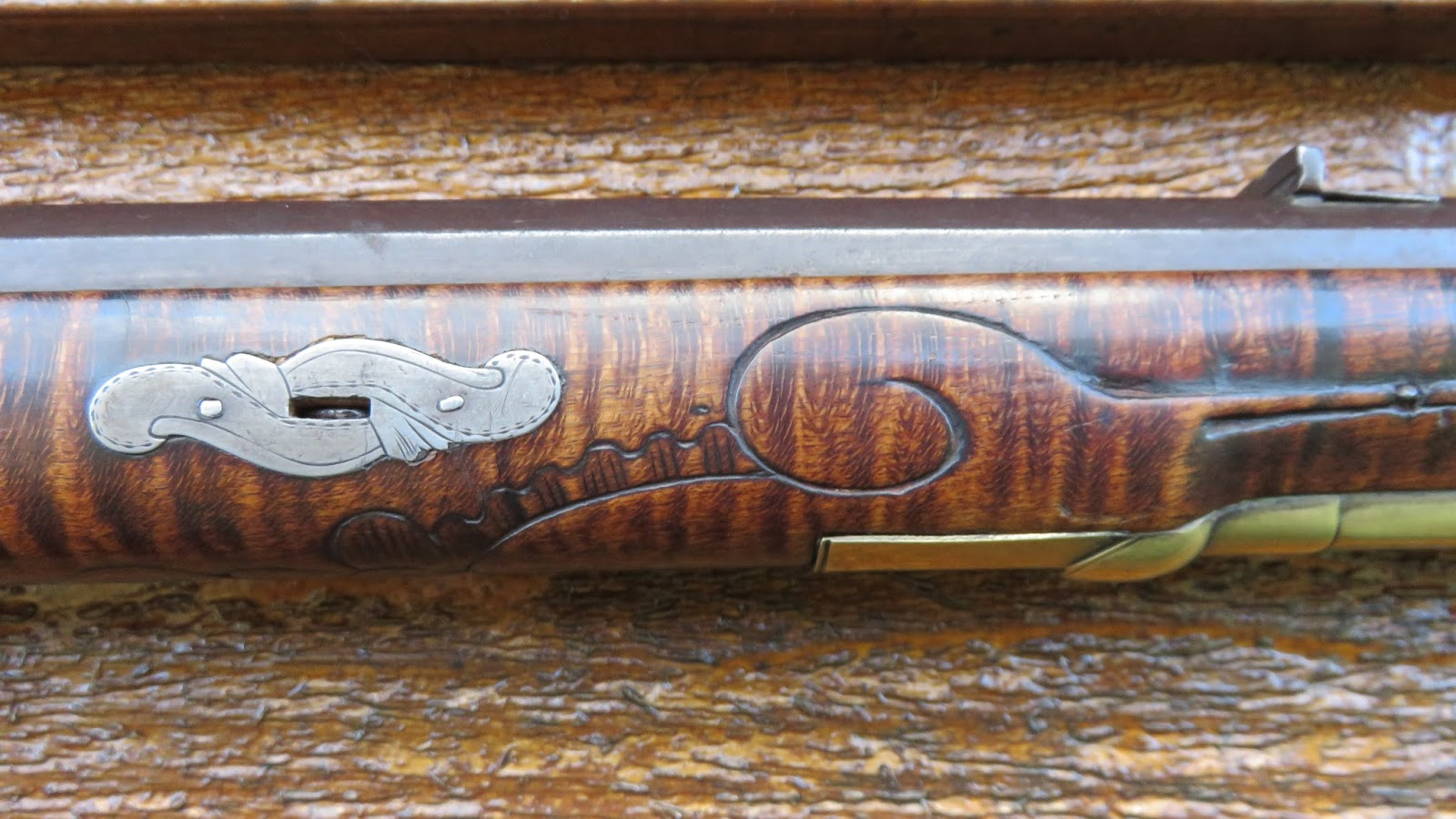 Wire inlay on gun stock carving t guns