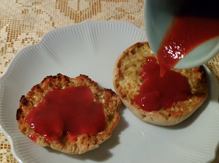 Pouring Strawberry Syrup onto English Muffin