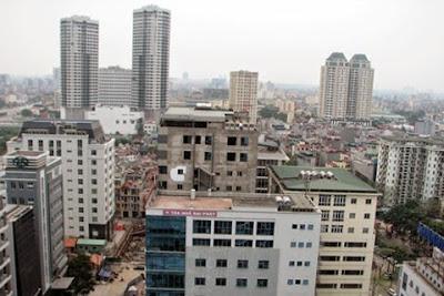 """Hà Nội: Ế ẩm, cao ốc nội đô hạ giá để """"vợt"""" khách"""