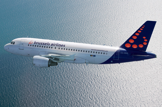 A Brussels Airlines air bus flying over an ocean