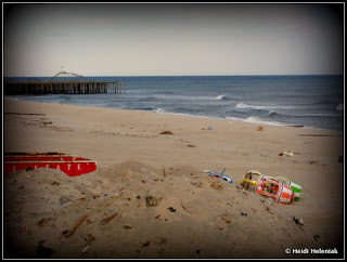 The sandy beach near Funtown Pier, Seaside Heights, NJ January 2013 after Hurricane Sandy. Rollercoaster in distance