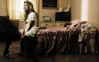 Marisa miller seat on the bed