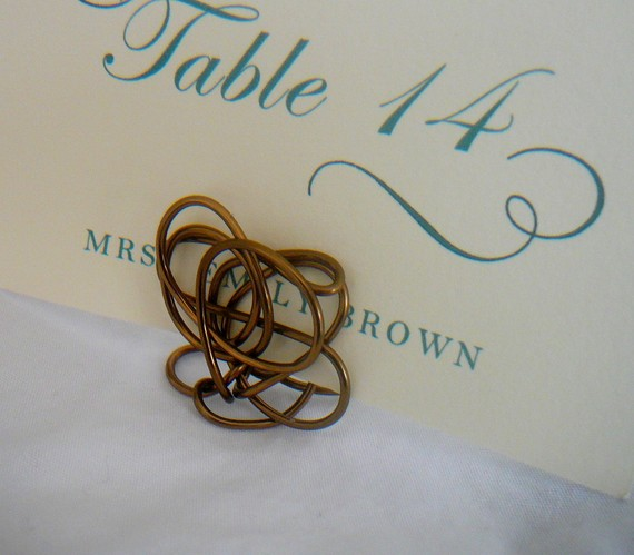 Homes and Weddings makes these twisty place card holders out of various