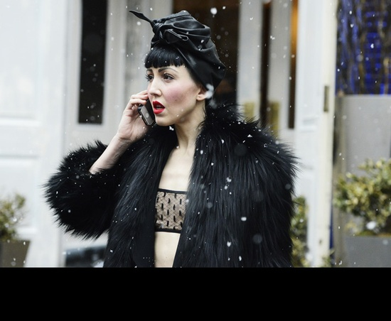 black furry margiela coat over lingerie with satin turban