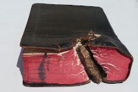 Image of the Bible pierced by shrapnel=
