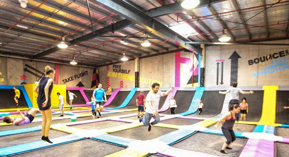 people bouncing on wall-to-wall trampolines at Bounce Inc.