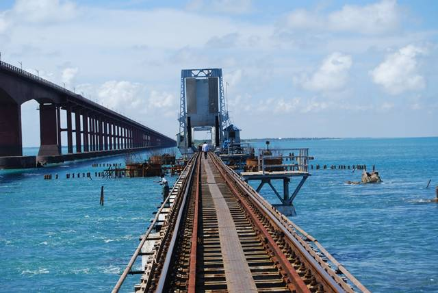 The Pamban Bridge  is a cantilever bridge on the Palk Strait connects Rameswaram on Pamban Island to mainland India. It refers to both the road bridge and the cantilever railway bridge, though primarily it means the latter. It was India's first sea bridge. It is the second longest sea bridge in India (after Bandra-Worli Sea Link) at a length of about 2.3 km. The rail bridge is for the most part, a conventional bridge resting on concrete piers, but has a double leaf bascule section midway, which can be raised to let ships and barges pass through.