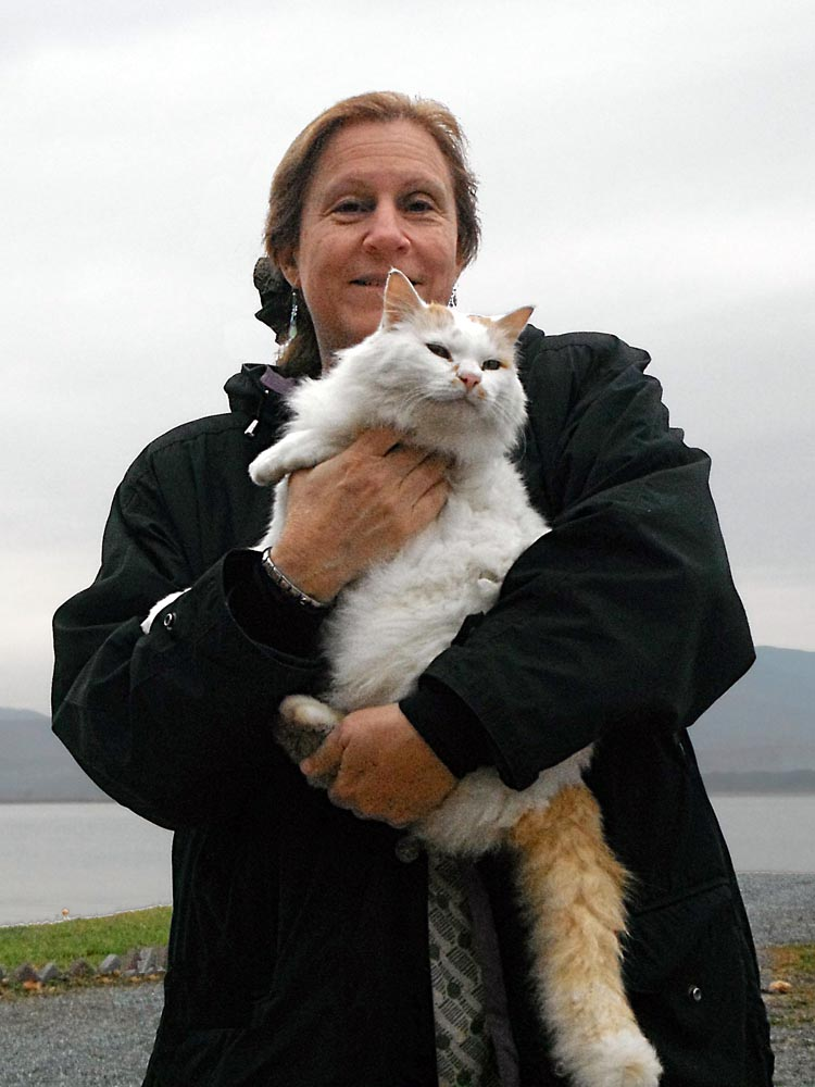 Leslie Harris and a big white fluffy cat