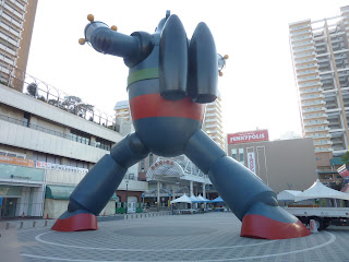 Giant 18 metre tall Tetsujin 28-Go (Gigantor) statue in the Nagata ward of Kobe. As seen from behind with his jetpack visible