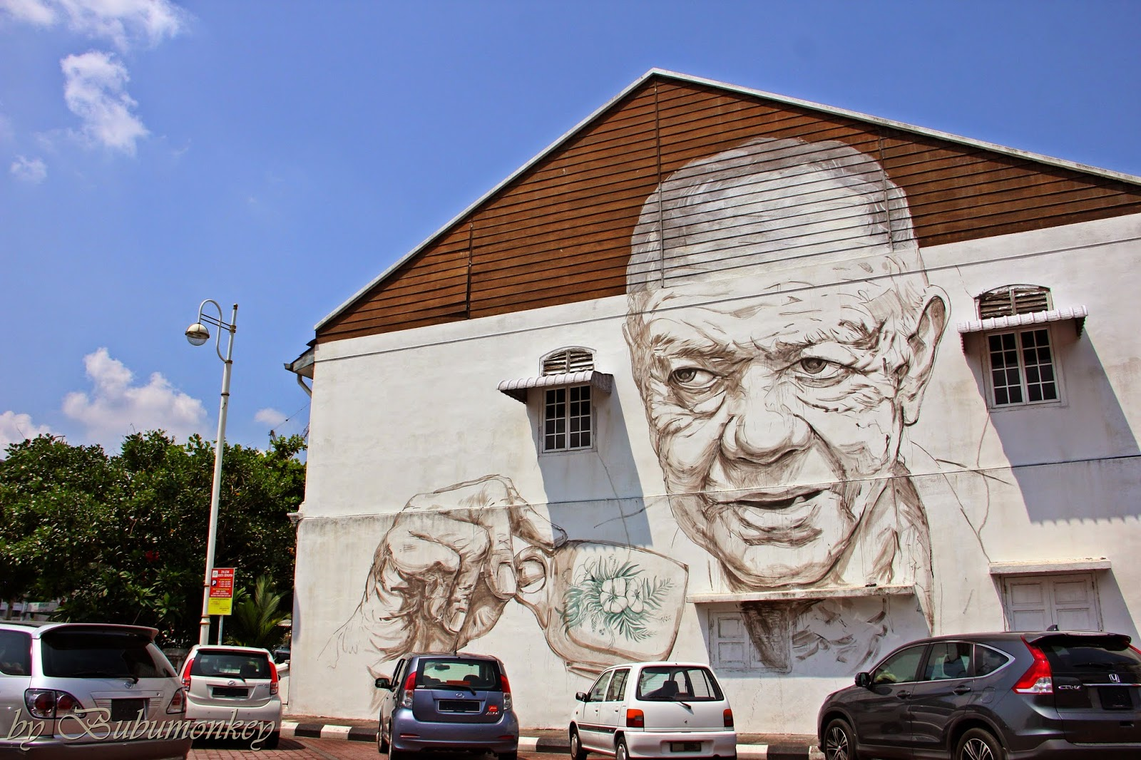 Monkey eye ernest zacharevic 39 s murals ipoh old town for 7 mural ipoh