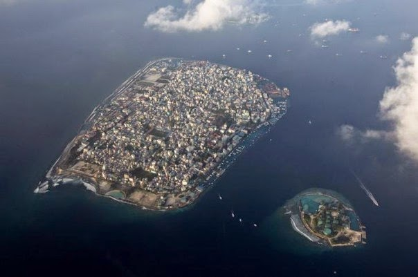An aerial view of Male, capital of the Maldives, a group of low-lying atolls and islets whose fishing and tourism are being hit by climate change. (Credit: Reuters/Reinhard Krause) Click to enlarge.