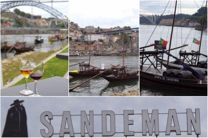 Puente Luis I desde Vila Nova de Gaia, barcas en el río Duero, y bodega Sandeman en Oporto, Portugal