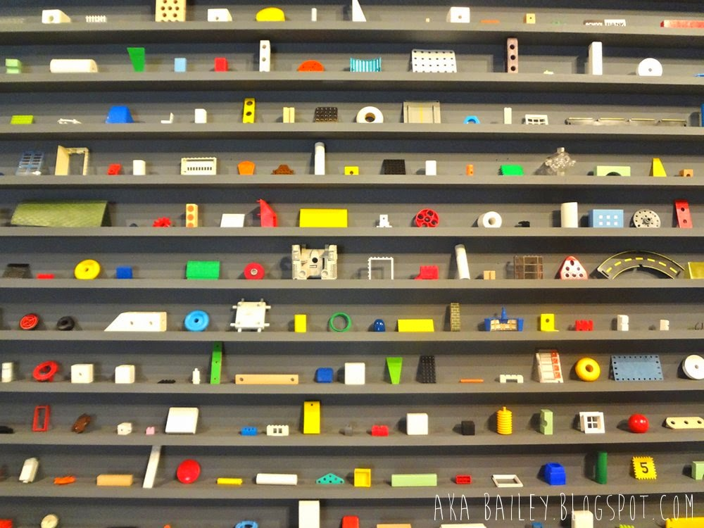 Douglas Coupland art, neatly arranged knick-knacks on shelves