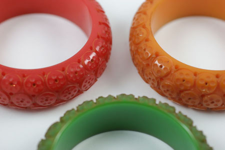 Red green and mustard Bakelite bracelets