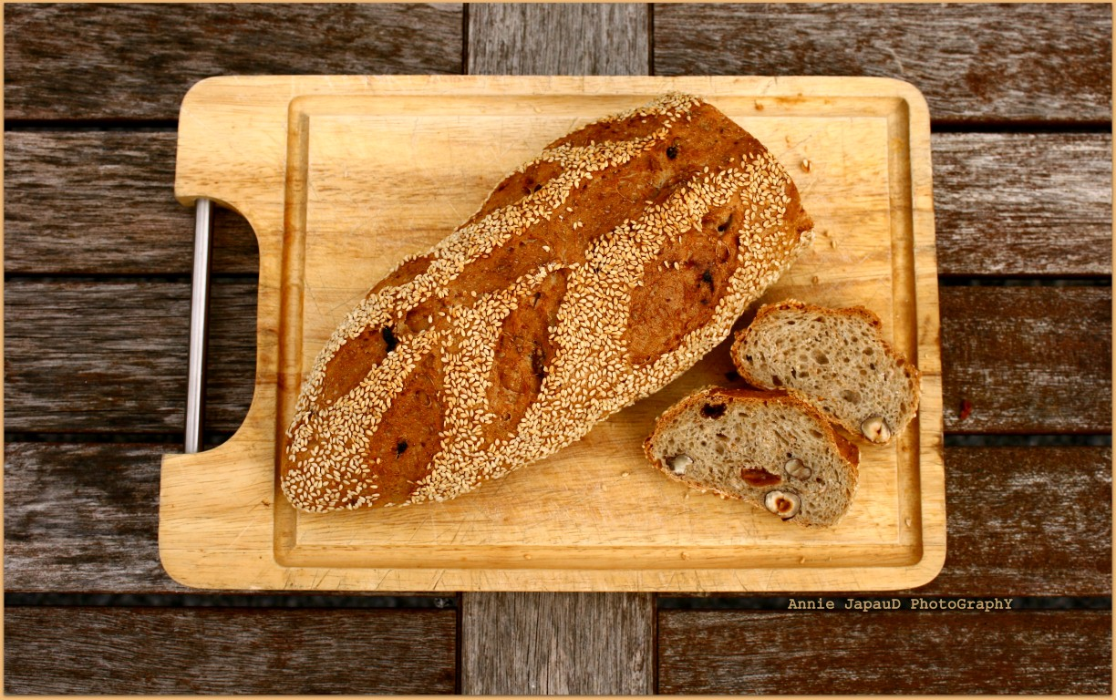 sesame seeds topped bread with hazelnuts