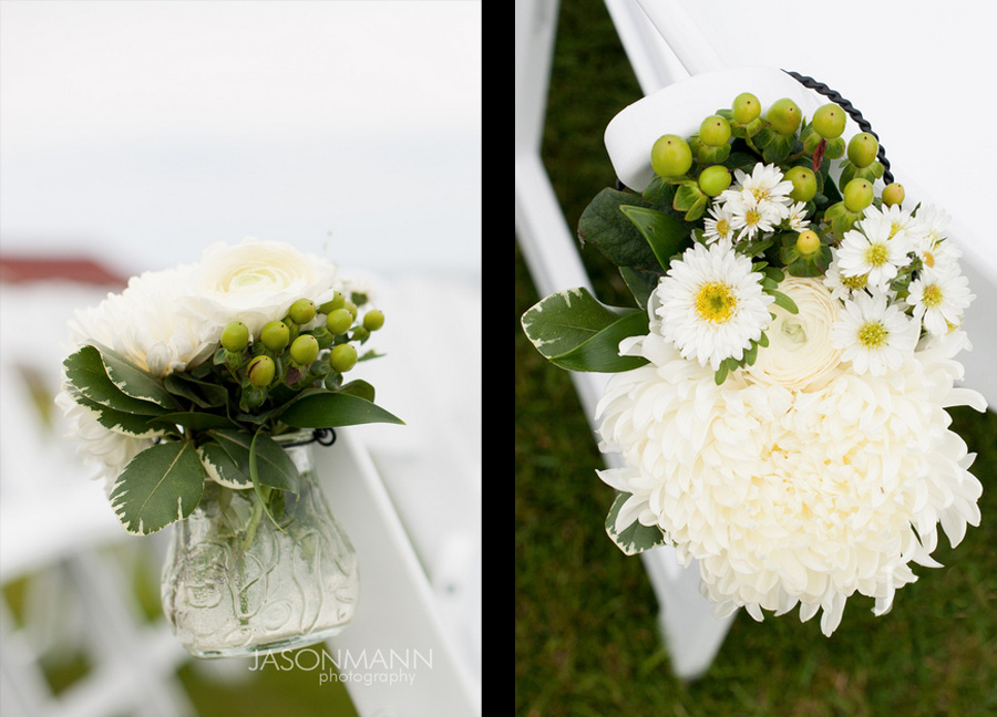 Small vases of white and green flowers lining the ceremony chairs. Door County lake wedding. Flowers by Flora. Photo by Jason Mann Photography, 920-246-8106, www.jmannphoto.com