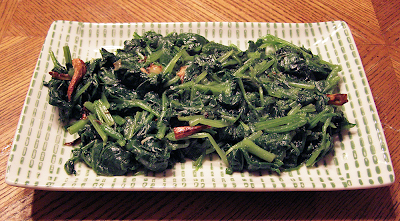 Spinach with Garlic on Green Bamboo Plate
