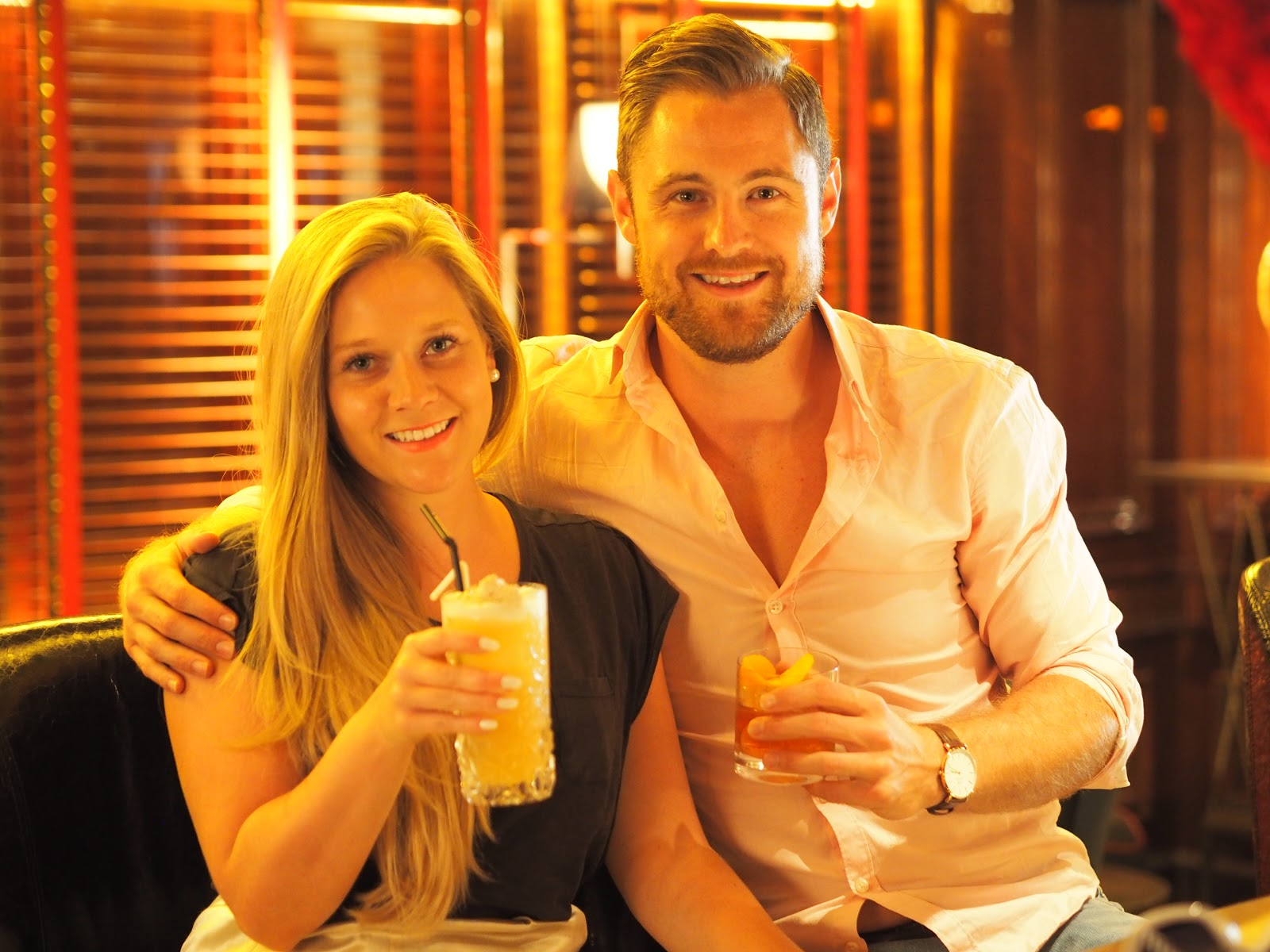 Couple sitting at The Bar, Peninsula Hotel, Hong Kong