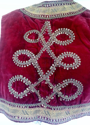 back of red velvet antique vest