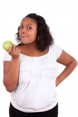 Picture of a woman holding an apple