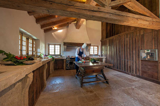 Picture of luxury kitchen with stone and wood walls and furniture