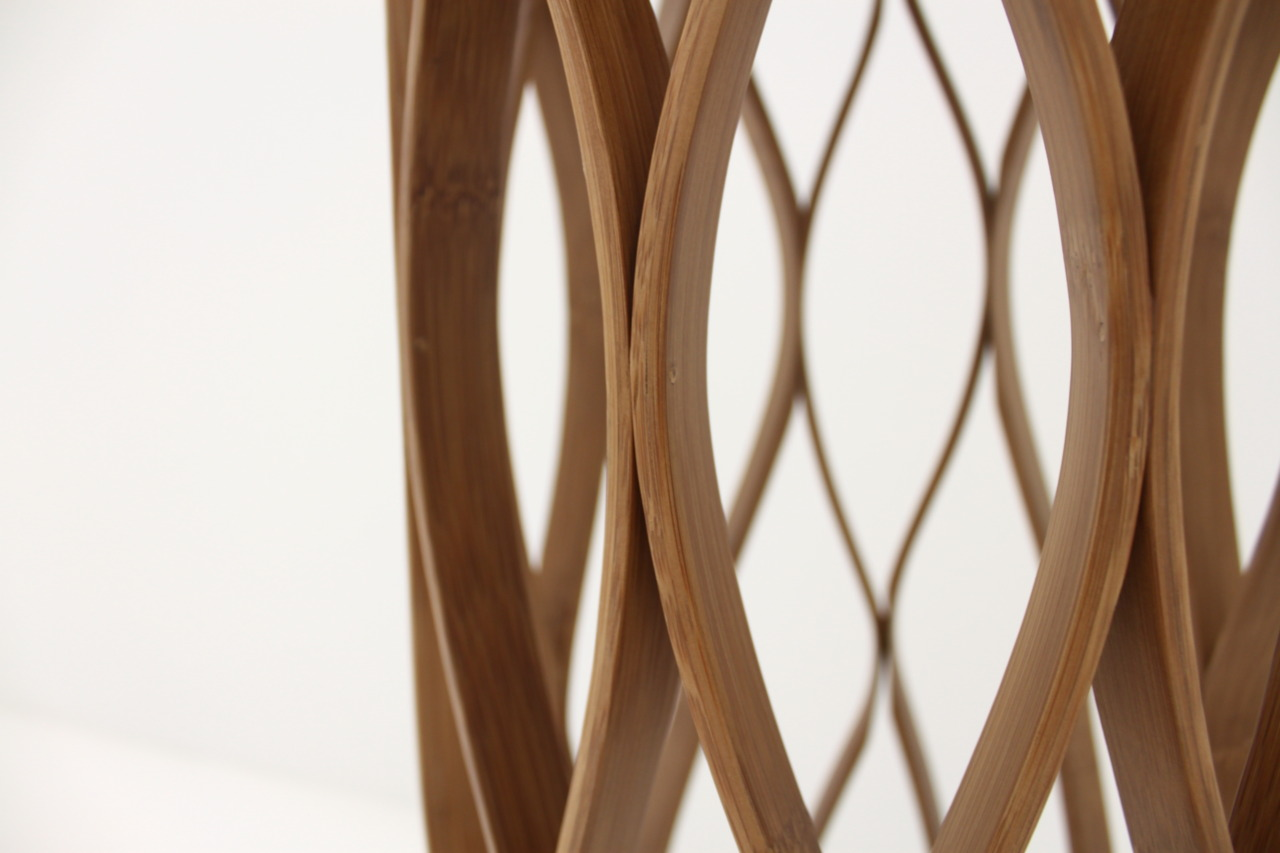 Honeycomb chair is a high chair made of bamboo the bamboo is bent to