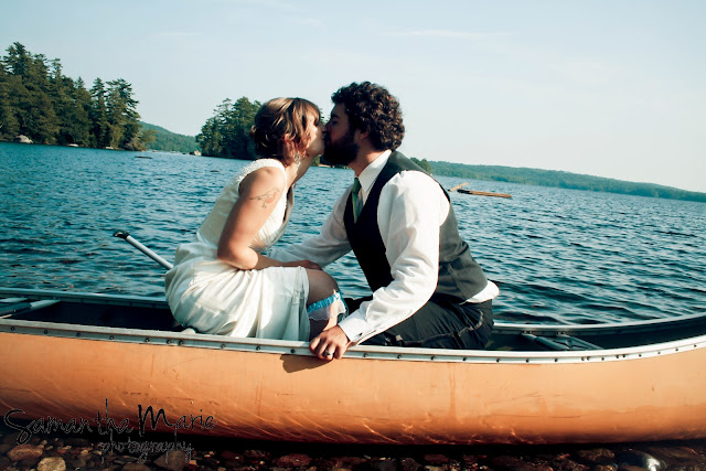 bride and groom kissing in a canoe