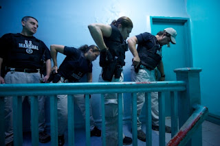 U.S. Marshals raid home of a fugitive.