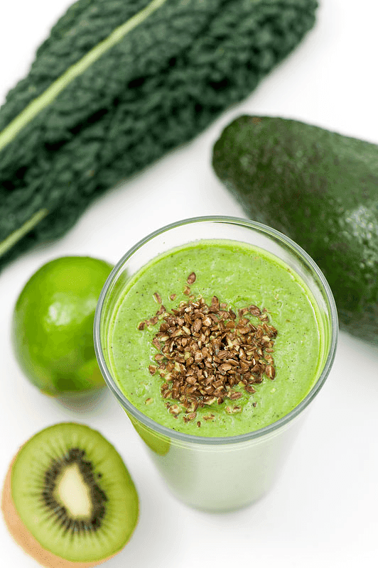 Green smoothie Kale kiwi avocado and lime close up