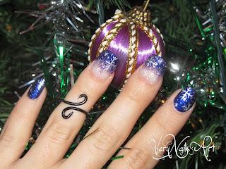 Uñas de navidad con copos de nieve