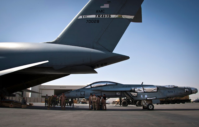 Loading an F/A-18 Super Hornet onto a C-5 Galaxy.