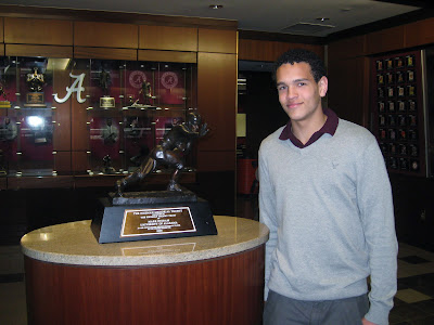 4* WR Derek Kief posing next to the 75th Heisman rewarded to Alabama Running Back Mark Ingram