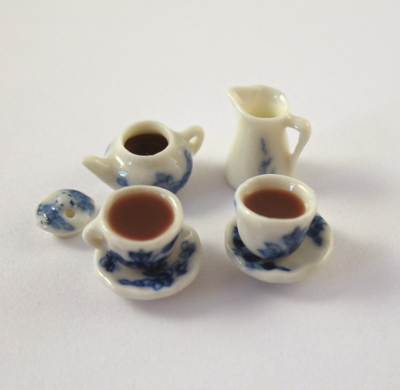 https://www.etsy.com/listing/206844673/dollhouse-miniature-food-tea-set-in-24th?ref=shop_home_active_1