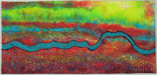 Fluid Fissure 3 quilt in reds, yellows, turquoise line, with embroidery